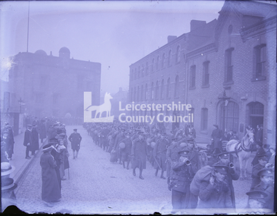 """Fully accoutred troops of Leics. Regt. Marching down Newarke St."""