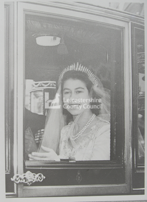 Elizabeth II, looking out of coach window