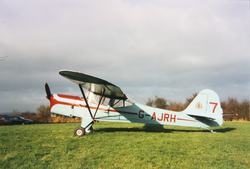 Auster aircraft on grass, registration G-AJRH