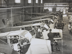 Factory Interior with aircraft and workers
