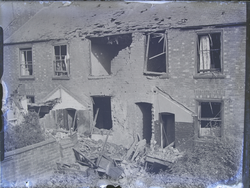Row of damaged flats from yard
