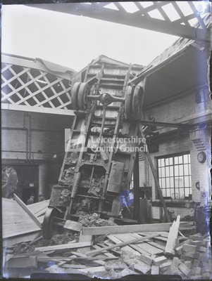 Leicester: Gypsy Lane 1940: Large vehicle flipped upright inside ruined building