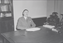 Unidentified civic official seated at desk