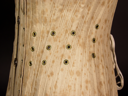 Ventilated corset with removable busk, 1885: Detail of eyelets