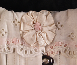 White long skirted corset, 1918: Detail of bow